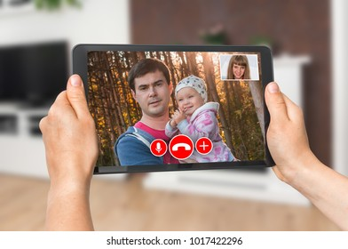 Woman online talking with her family - video call concept