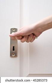 Woman open a door