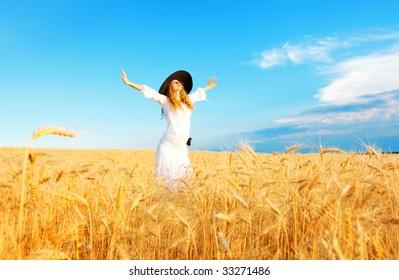 woman in open field in summer