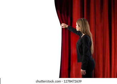 Woman open red curtains of the theater stage. blank space for your text