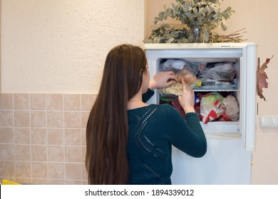 woman opened the refrigerator and gets food