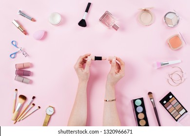Woman opening her lipstick on dressing table