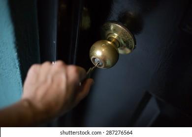 Woman opening a locked door