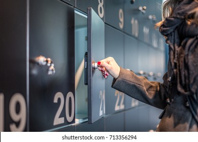 Woman opening a locker at the museum