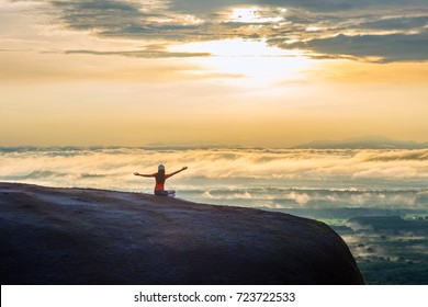 Woman Opens Her Arm, Enjoy the Fresh Air and Embrace the Nature on the three whale rock mountain at Phu Sing , Bueng Kan Province,Thailand
