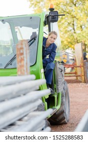a woman is operating telehandler