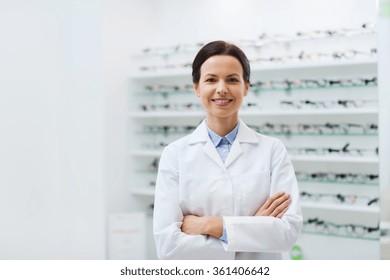 woman optician over glasses at optics store