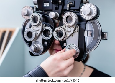 Woman at optometrist or doctor having eye sight testing