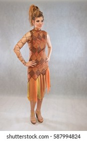 Woman in orange and brown outfit fashion studio