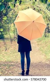 Woman with orange umbrella/toned photo