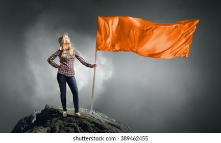 Woman with orange waving flag