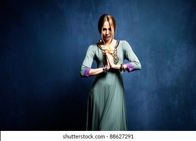 woman with orchid in hands, studio shot