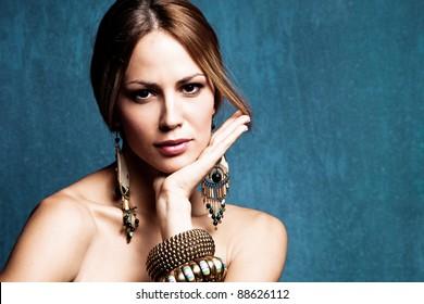 woman with oriental jewelry portrait, studio shot