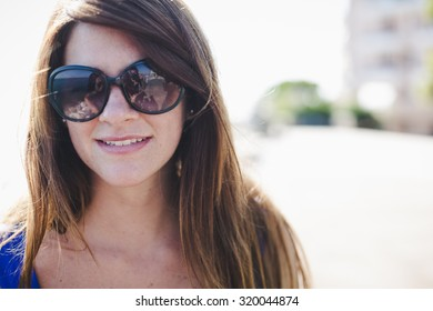 Woman Outdoor during a beautiful day of summer.