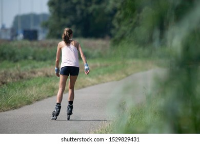 woman outdoor skating in the open field