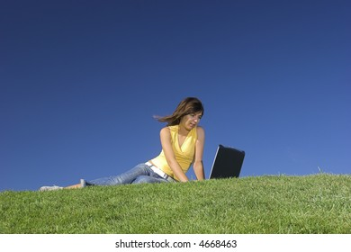 Woman in outdoor study with a laptop
