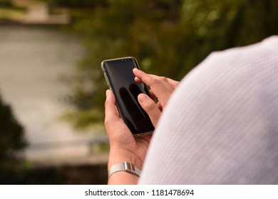 Woman outside with cellphone