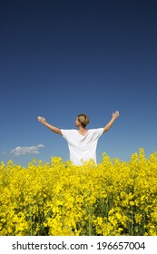 Woman with outstretched arms on a Rape Field