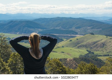Woman overlooking valley on Mt Robert, Nelson Lakes National Park, New Zealand.