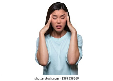 Woman overwhelmed with stress and concern, confusion and doubt, hands to head, isolated on white background