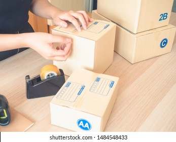 A woman are packing box for preparing to send goods to customer.