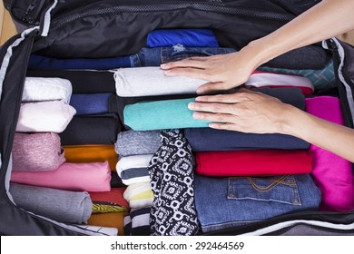 a woman packing a luggage for a new journey