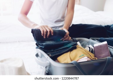 Woman packing travel bag for summer vacation. Tourism and objects concept, suitcase for summer holidays