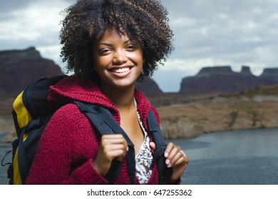 Woman with packpack in wilderness