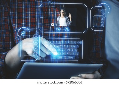Woman with pad communicating with friend via abstract futuristic screen hologram. Concept of network, communication, family, technology, augmented reality and future