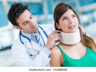 Woman in pain at the doctor for a neck injury