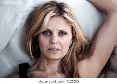 Woman in pain having problems sleeping