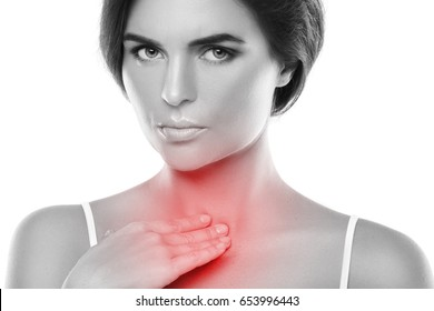 Woman with a pain in her throat on white background