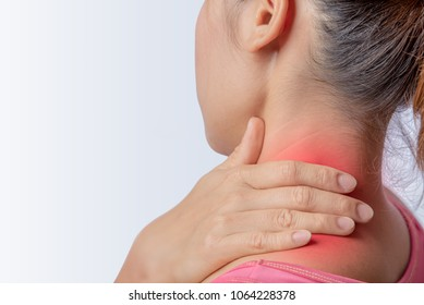 woman pain at trapezius muscle and holding right hand on muscle, swelling and inflammation of left rotator cuff muscle