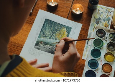 Woman Painter Artist Painting A Picture Of A Fantasy Cave With Watercolour