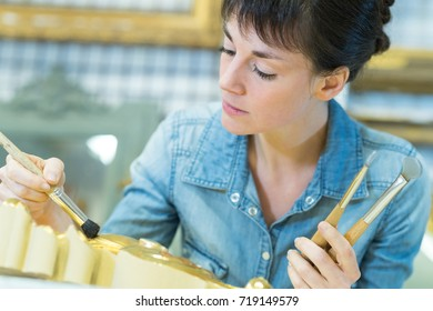 woman painting a frame