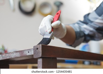 woman painting furniture