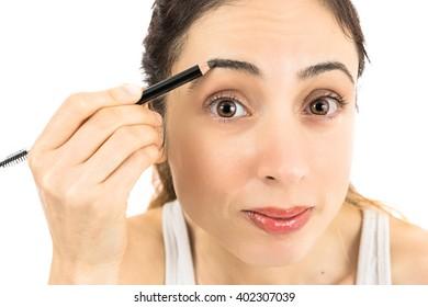 Woman painting her eyebrow