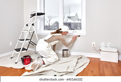 Woman painting trim