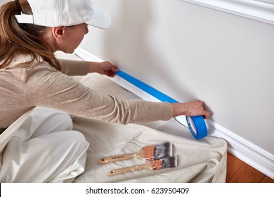 Woman painting wall