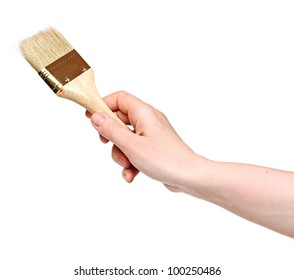 woman painting a wall with a brush