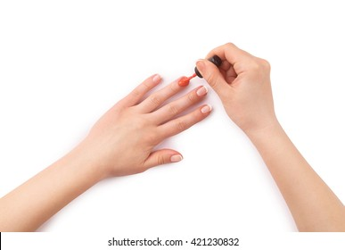 woman paints her nails on white