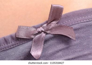 Woman in panties bow macro material fashion body