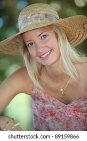 Woman in park wearing hat