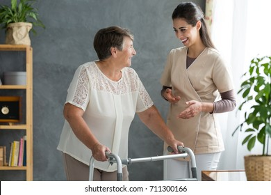 Woman with parkinson's disease chatting about the progress of her treatment with a friendly doctor