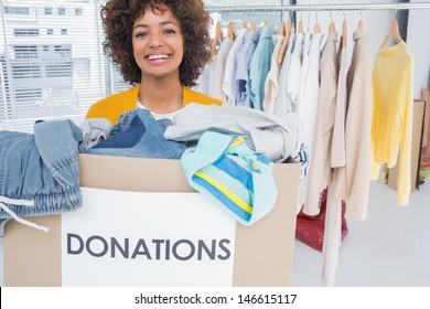 Woman participating at charity and holding donation box