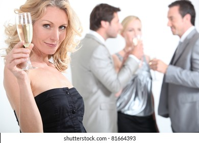 Woman at a party with a glass of champagne