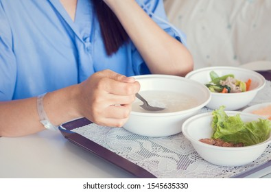 Woman patient hand with iv solution eating food for patient on bed in hospital. Health medical insurance concept.