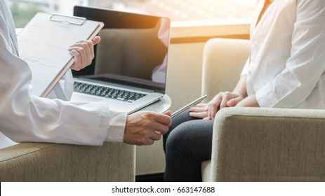 Woman patient having exam with gynecologist doctor getting consulting service in female health in medical clinic or hospital