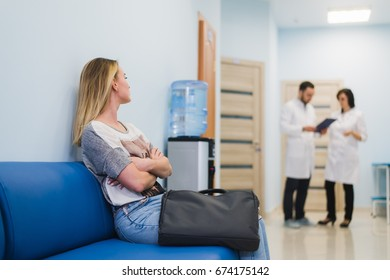 Woman patient waiting at hospital Doctors Waiting Room