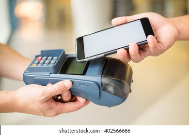 Woman pay by cellphone with NFC